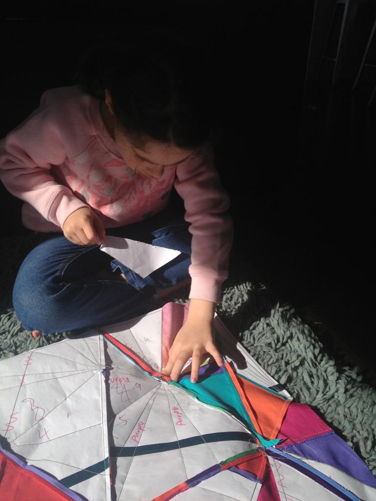 My mini-me helping rip the paper away