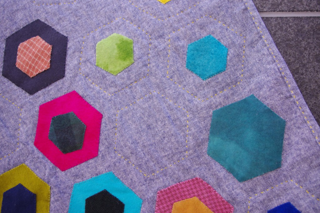 Love the way the hexagons dance around on the linen.