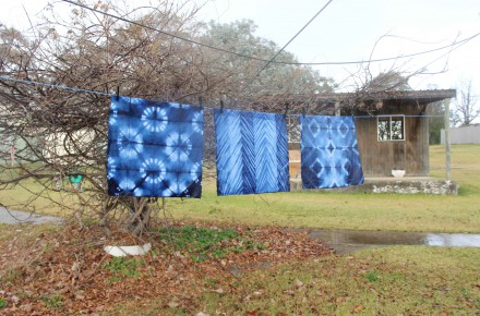 Three indigo squares hanging on the line